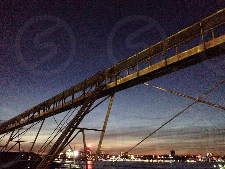 brown metal bridge during nigh photo