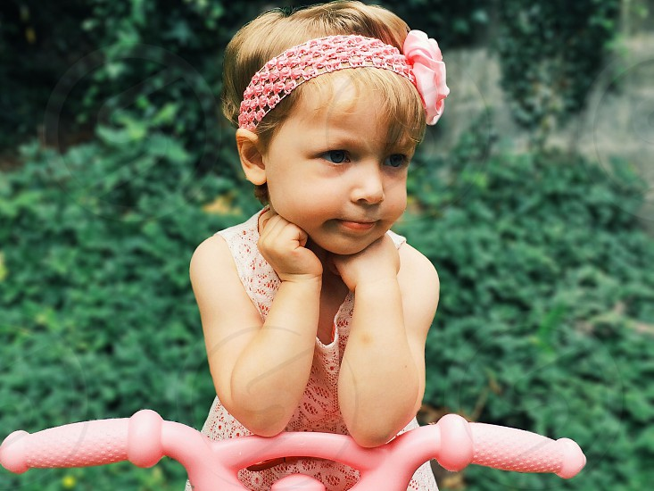 child's pink headband with pink flower photo