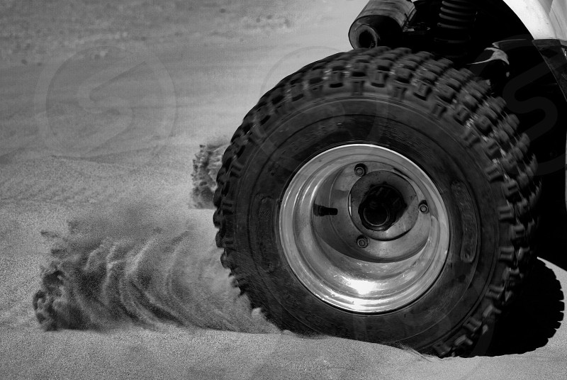 Sand thrown from tires photo