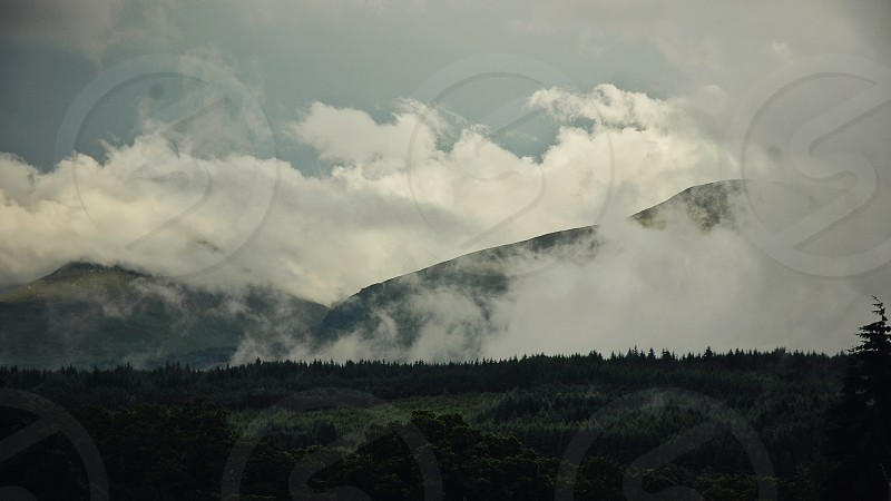 Mist in the mountains outside of Fort William Scotland. photo