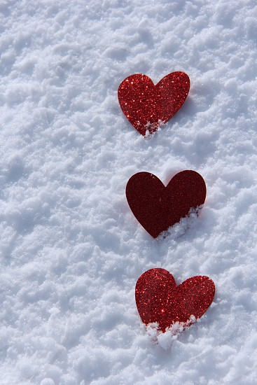 Love hearts red snow negative space photo
