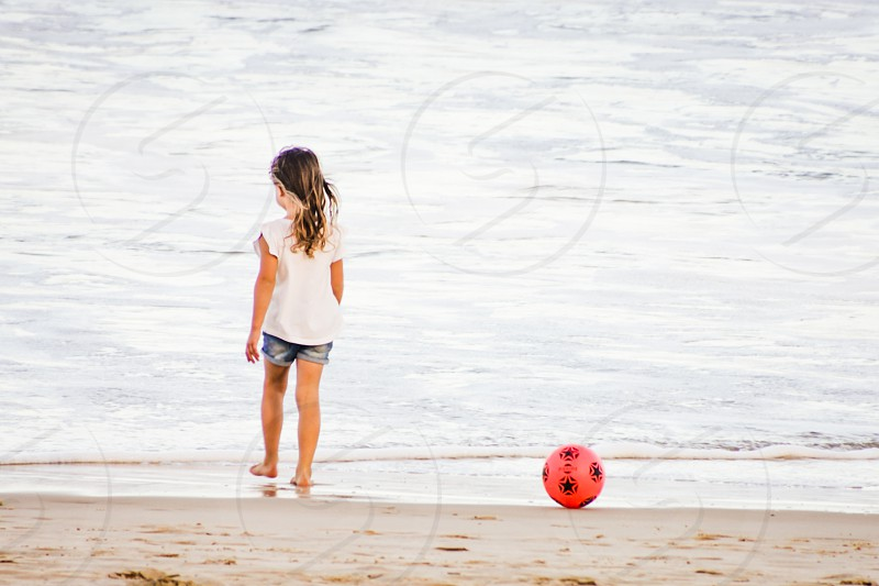 little girl at the beach on summer vacation  photo