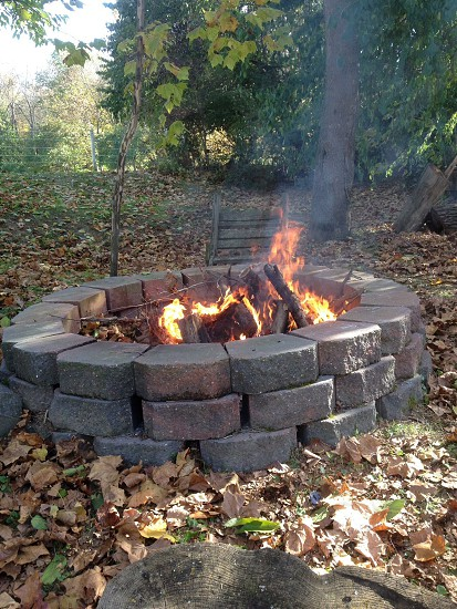 bonfire on a round paver fire pit photo