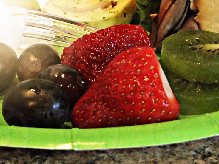 Fresh grapes strawberries and kiwi fruit photo