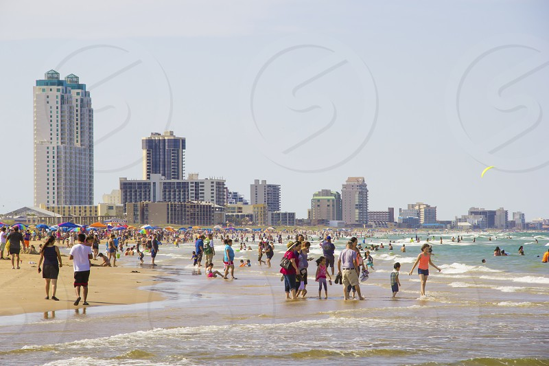 View of South Padre Island beach and hotels during summer where a lot of people visit.  photo