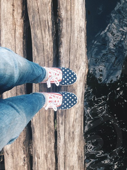 river legs berth gumshoes wood photo