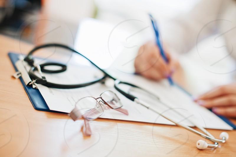 health clinic doctor analyzes nurse medicine medic treatment photo