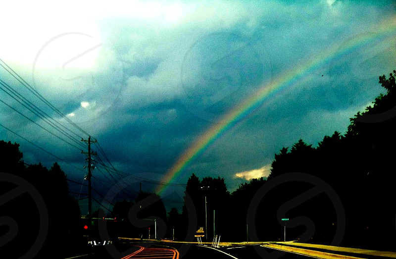 Rainbow in a storm. Abstract road photo