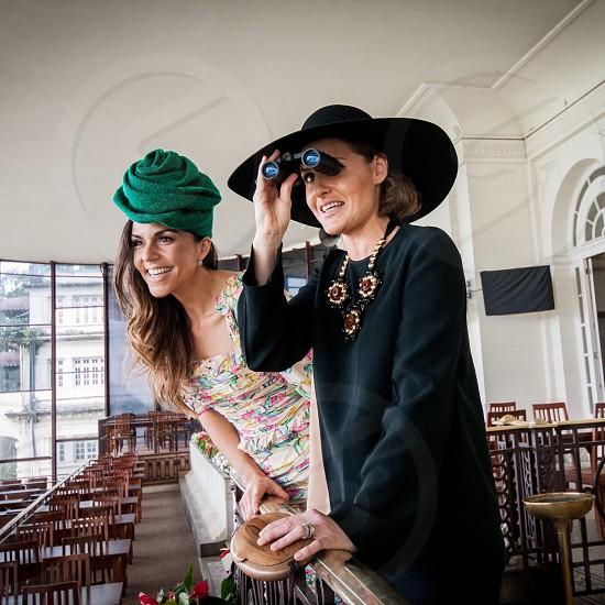 Best friends having fun race Jockey Club women fancy beautiful photo