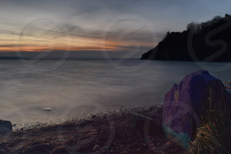 A long exposure taken by the shores of Lake Superior at Sunset photo