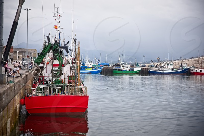Boats in the port of Santoña Spain photo
