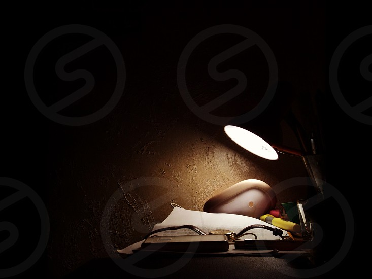 desk lamp and watch photo