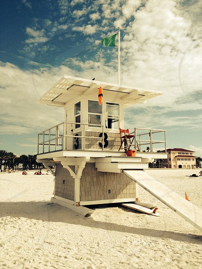 Lifeguard post on white sand beach photo