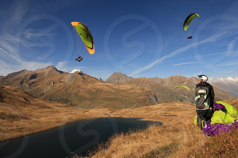Paragliding paraglide extreme sport sports active leisure mountains lifestyle  photo
