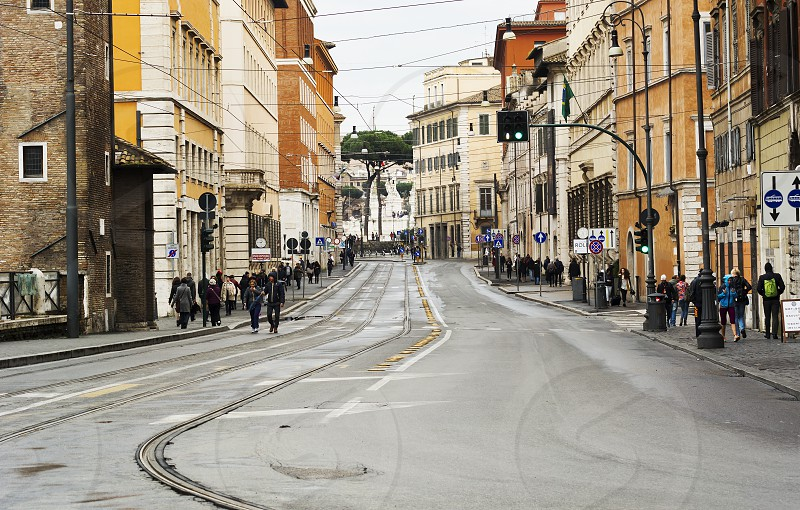 Rome Italy march 2015: view of Via delle Botteghe Oscure in Rome with the tram rails and people walking on a rainy day photo