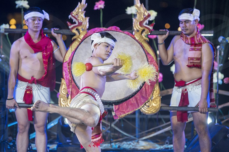 traditional Tha Drum Dance at the Loy Krathong festival at the fort Sumen at the Santichaiparakan park in Banglamphu in the city of Bangkok in Thailand.  Thailand Bangkok November 2017 photo