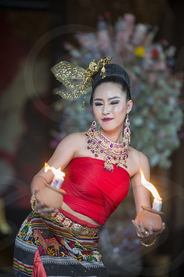 a Thai Dance Show at the Baandam Museum in the village of Muang in the north of the city Chiang Rai in North Thailand. photo
