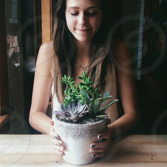 woman holding pot of succulent plant photo