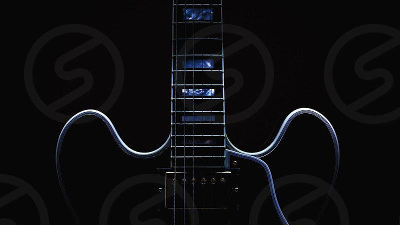 Body and neck of electric eguitar accentuated shapes by illumination.  photo