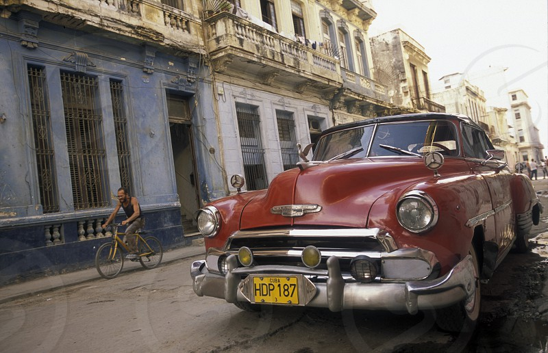 old cars in the old townl of the city of Havana on Cuba in the caribbean sea. photo