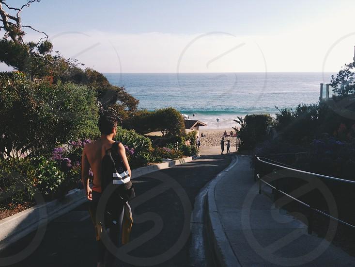 person riding a bike on concrete pathway photo