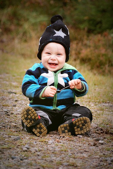 Little boy full of joy and happiness. Child toddler happy expressive photo