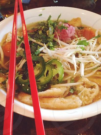 red chopstick on ceramic bowl photo