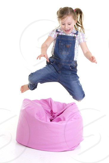 girl in gray and white shirt dress jumping photo