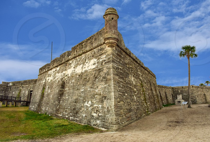 St. Augustine Florida. January 26  2019. Panoramic view of Castillo de San Marcos on lightblue background in Florida's Historic Coast (1) photo