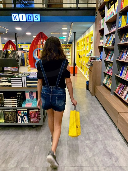 Girl entering bookstore to buy books photo