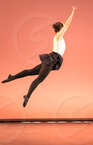 Woman Ballet Dancer Jumping In The Air photo
