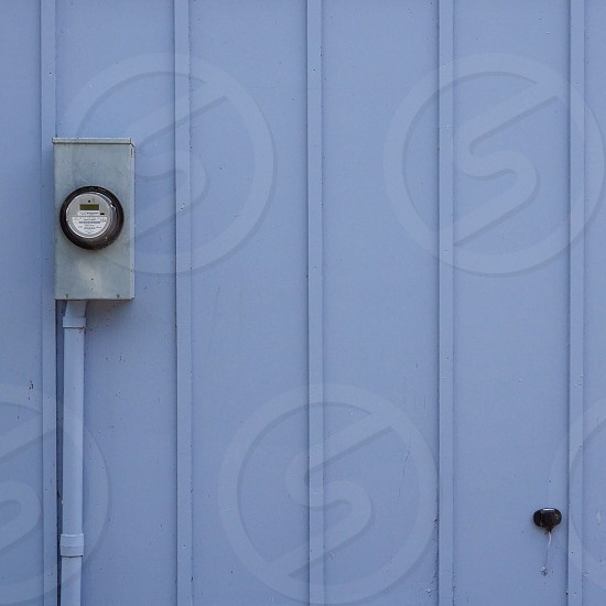 glass electric meter on wall photo