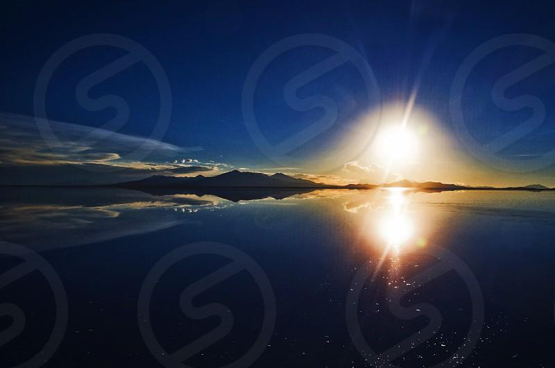 sunset salar uyuni with magic shapes photo