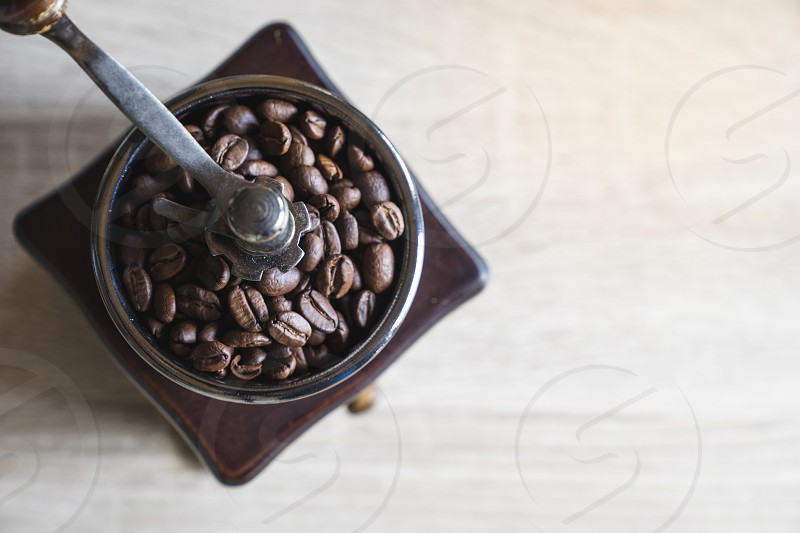 Roasted coffee beans in wooden coffee grinder. Top view .Copy space . photo