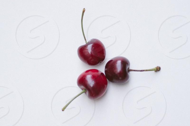 3 red cherries photo