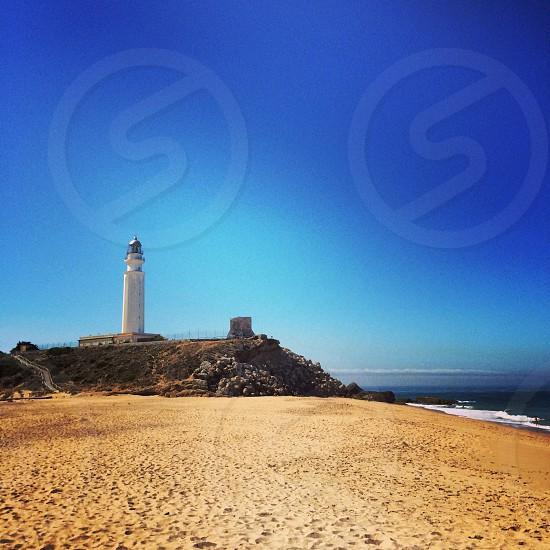 Cabo da trafalgar lighthouse sand beach spain atlantic sunny sky photo