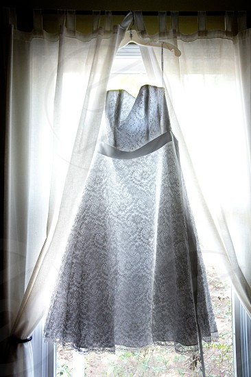 Lace wedding gown in the window photo
