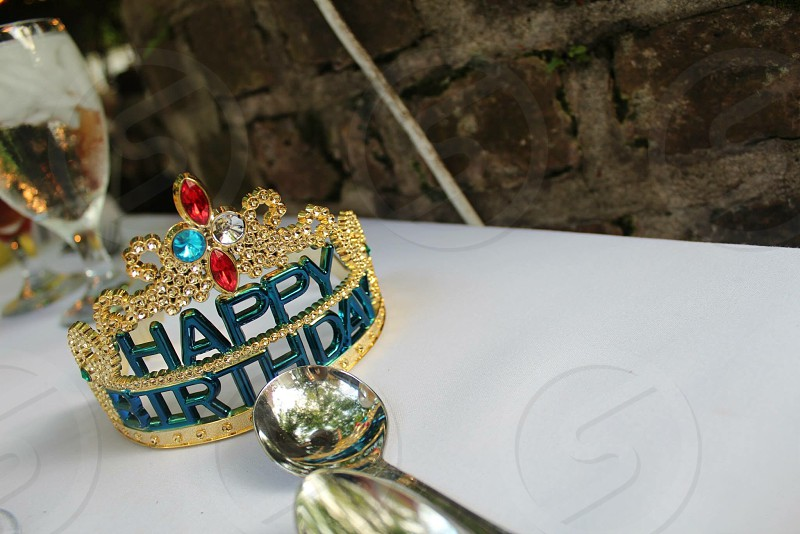 gold-colored happy birthday tiara photo