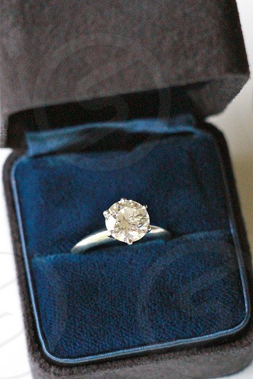diamond silver engagement ring in ring box photo