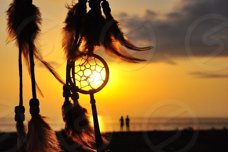 dream catcher and sun set photo