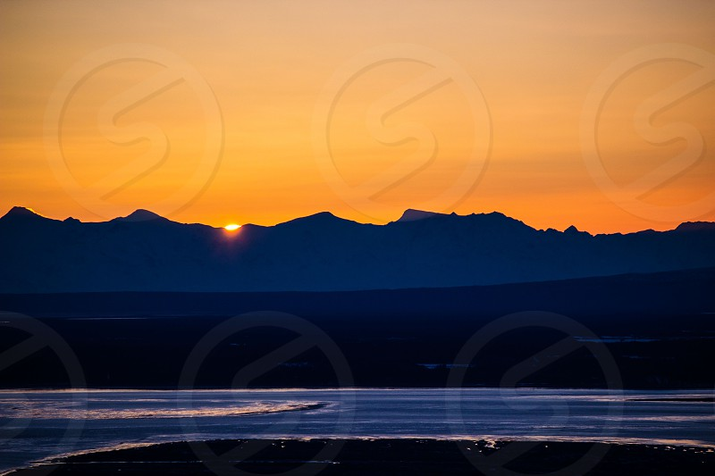 Sunset over the Cook Inlet in Eagle River AK.  photo