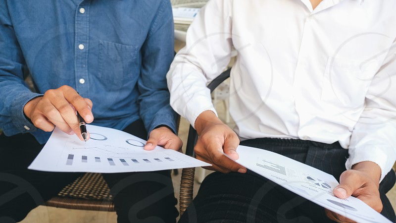 Young startup businessmen teamwork brainstorming meeting to discuss the new project investment.  photo