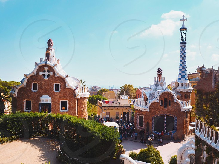 Park Guell in Barcelona. View to entrace houses with mosaics on foreground photo