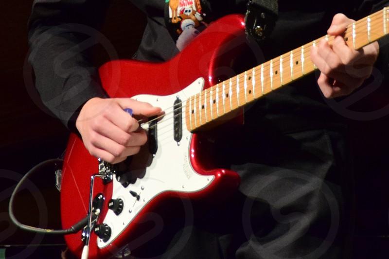 Millennial playing guitar photo