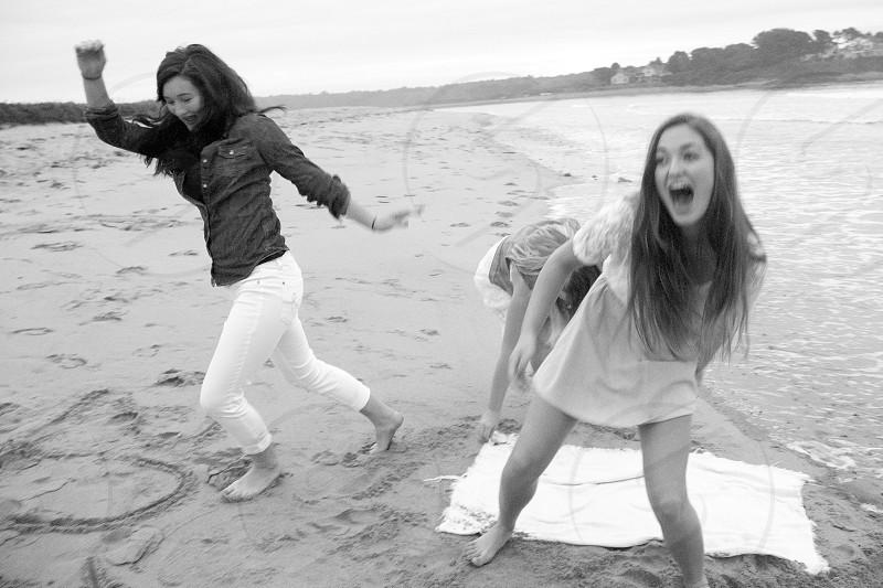 Teenage girls laughing beach photo