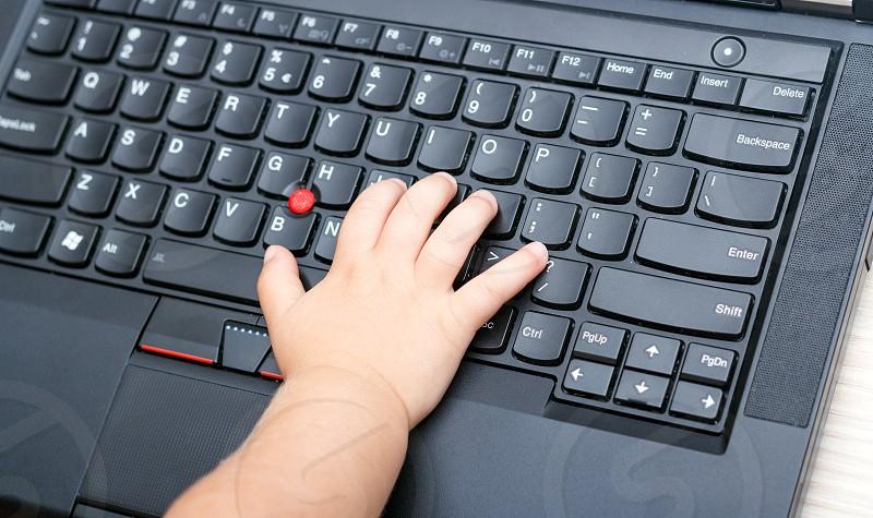 Using laptop for bussines figures data sheet children kids photo