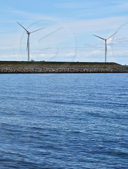 Wind farm along the Baltic Sea in Copenhagen Denmark photo