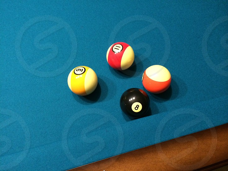 Pool table boxed in trapped cornered resistance out numbered challenge opposition under dog eight ball photo