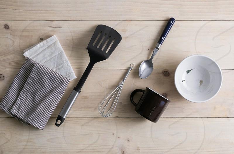 Cooking utensil on wooden floor photo