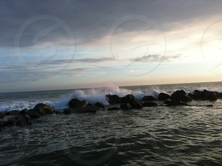 Waves crashing on rocks at Coronado beach in San Diego California. Ocean photo